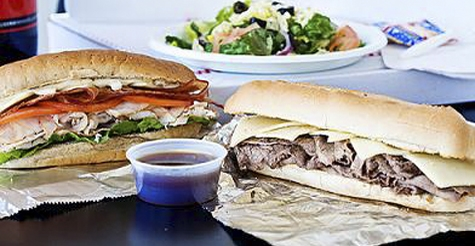 $10 for $20 of food & drink at St. Louis Pizza & Wings